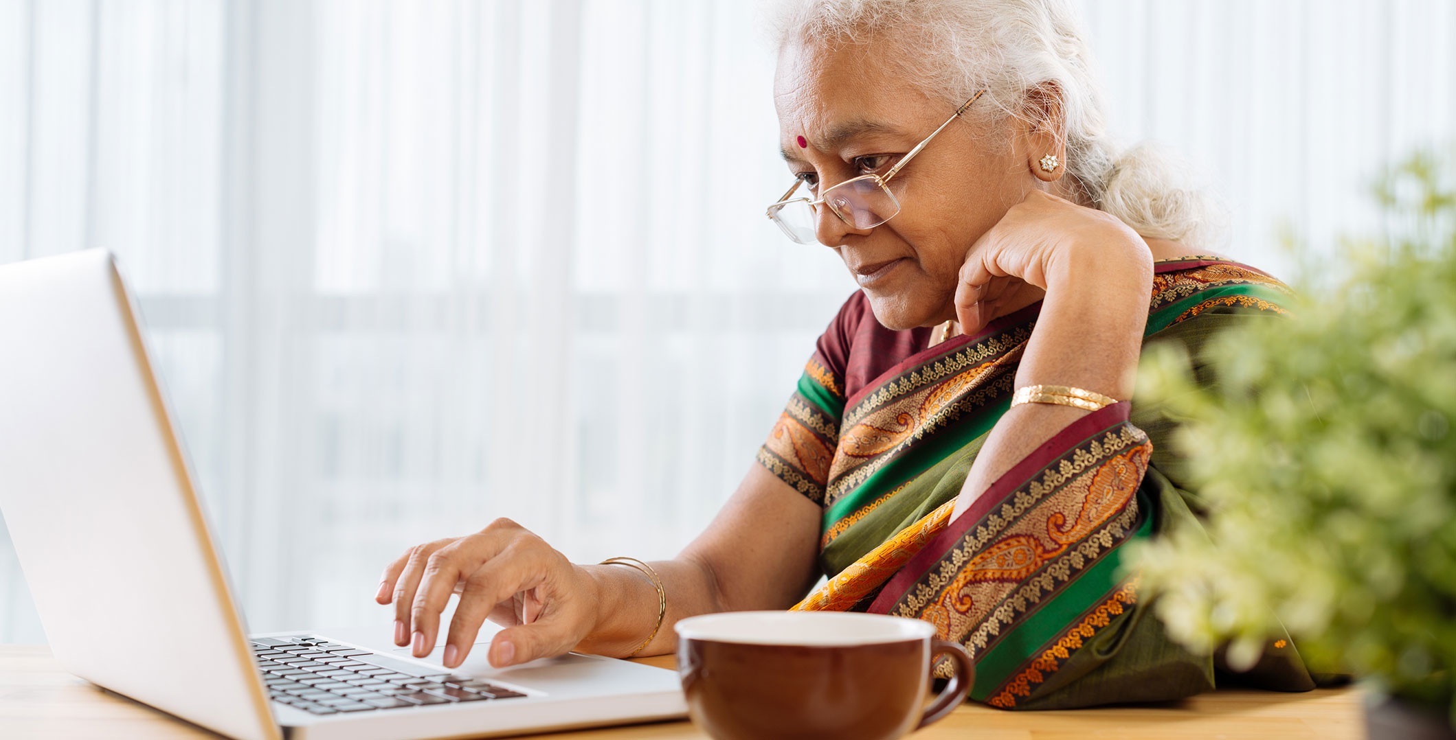 Indian lady working on laptop